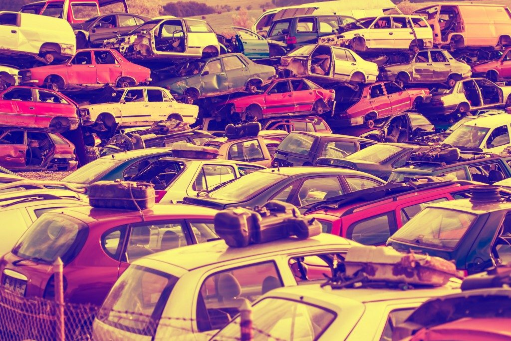 car wrecks top of each other in the scrap yard