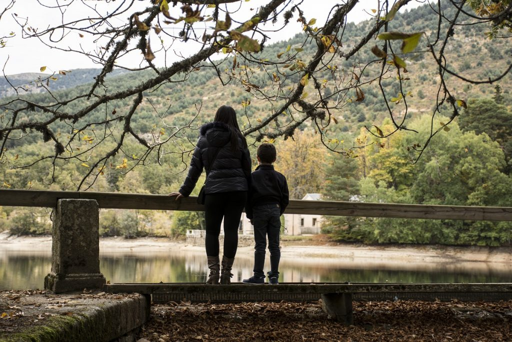Mother and son looking at the lake