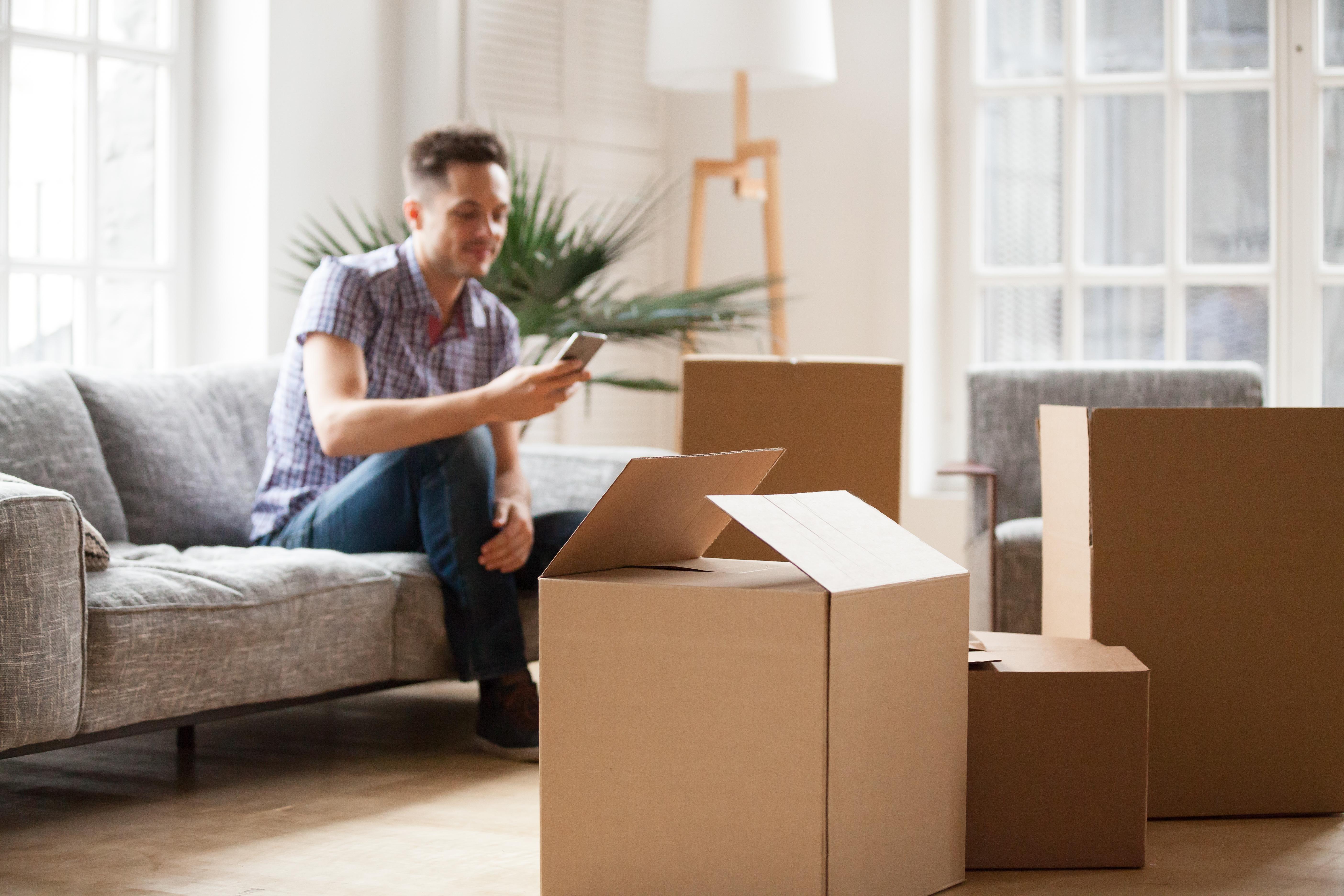 Man unpacking his things
