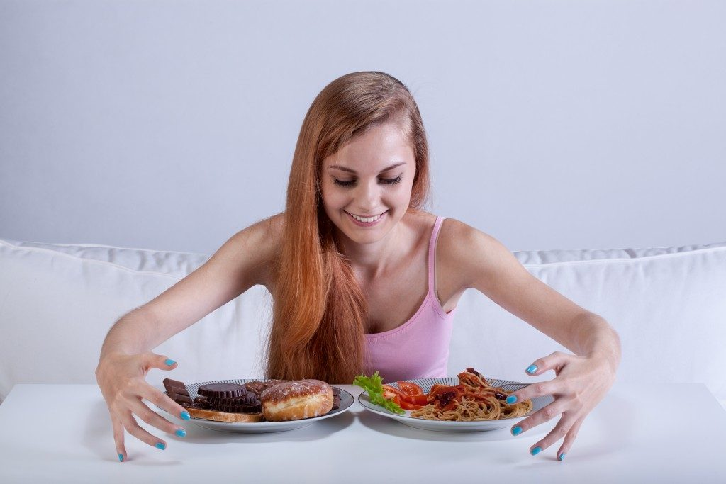 woman eating a lot of food