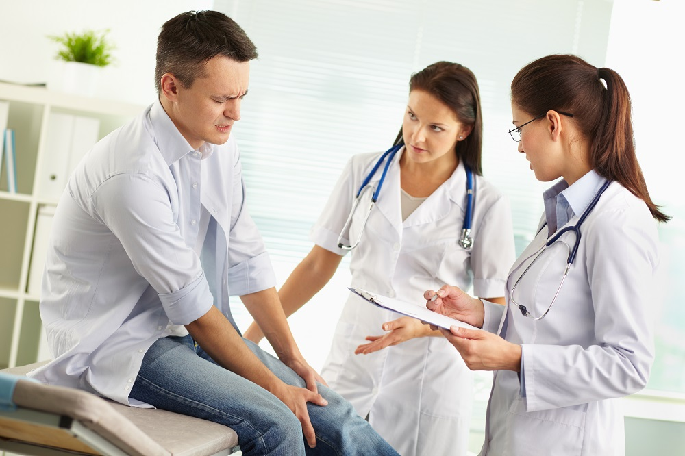 physician assessing patient