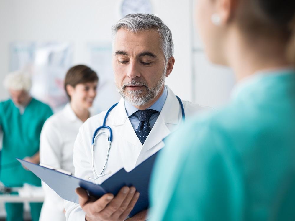 doctors reviewing patient files