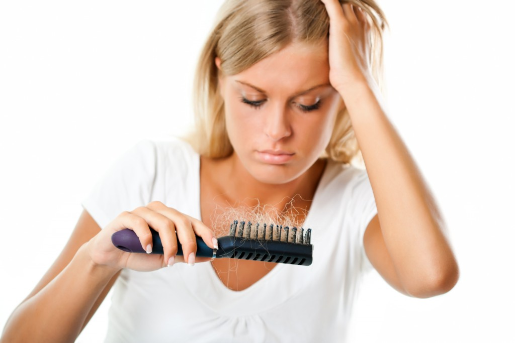 Blonde girl worried about hair loss,Hair loss
