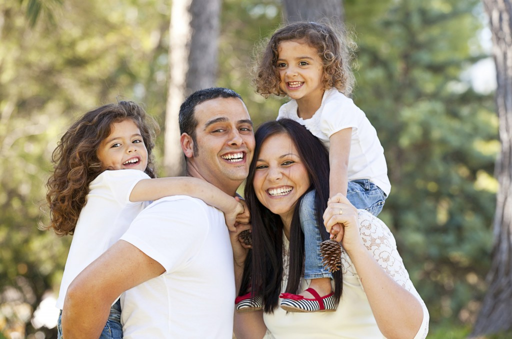 married couple with two young daughters