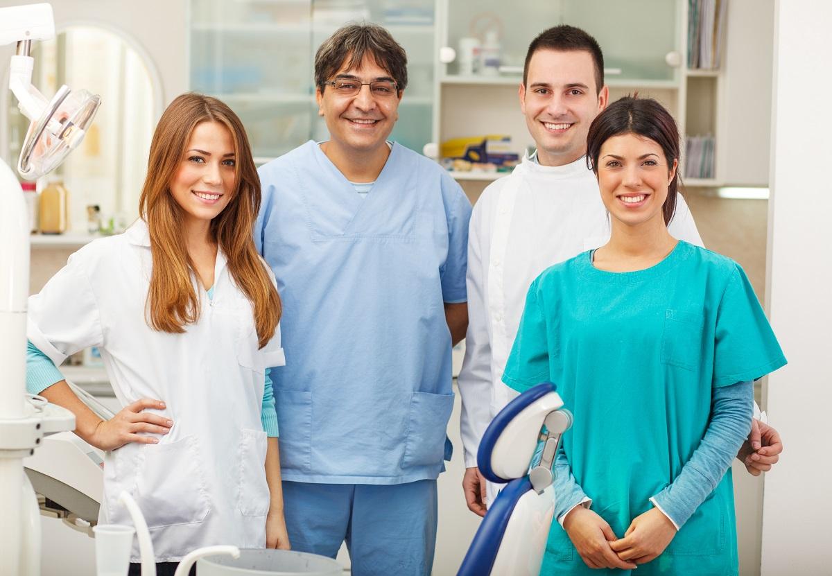smiling denstists and assistants