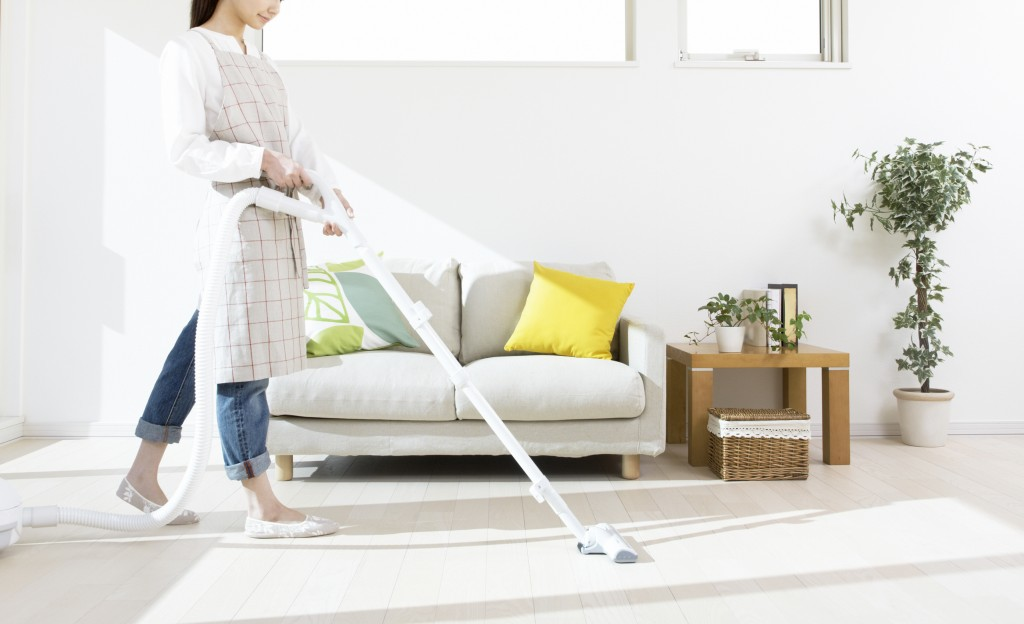 girl cleaning the living room