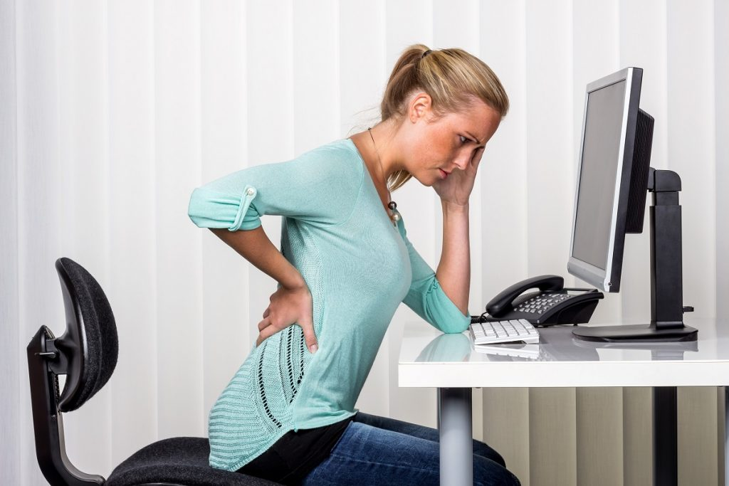 woman suffering with backpain