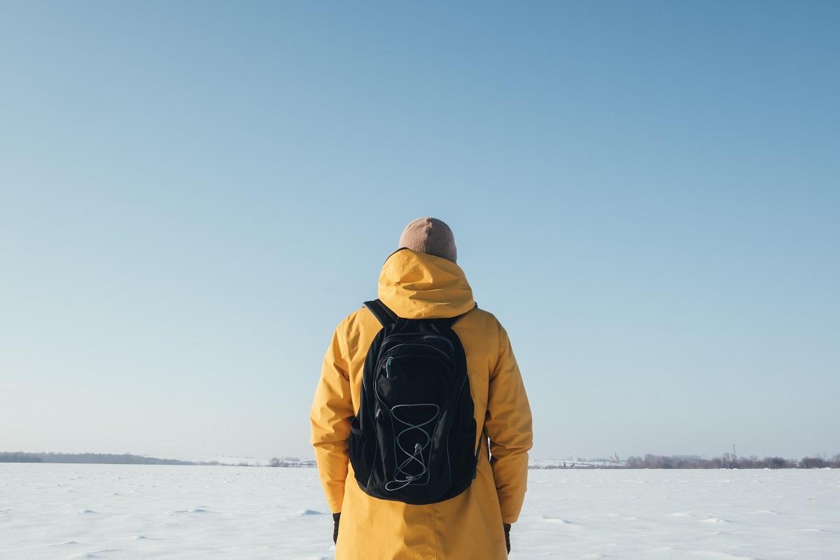 Alone traveler in yellow jacket