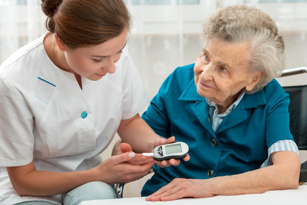 nurse and senior patient