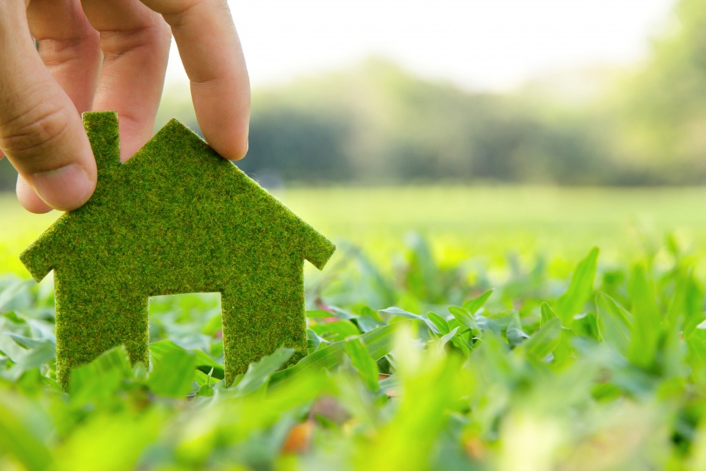 green miniature house