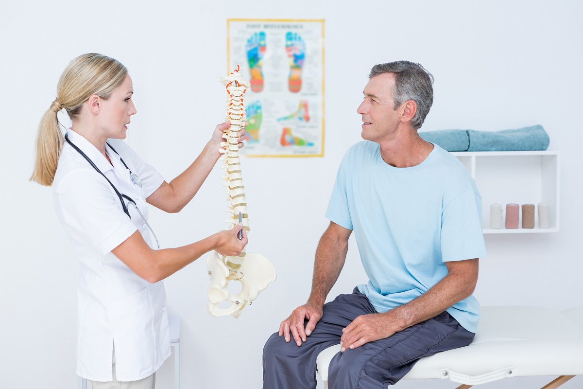 man consulting an orthopedist