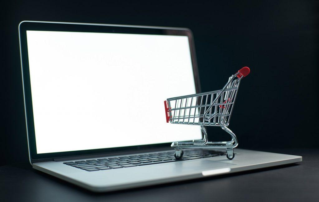 miniature cart on top of a laptop keyboard