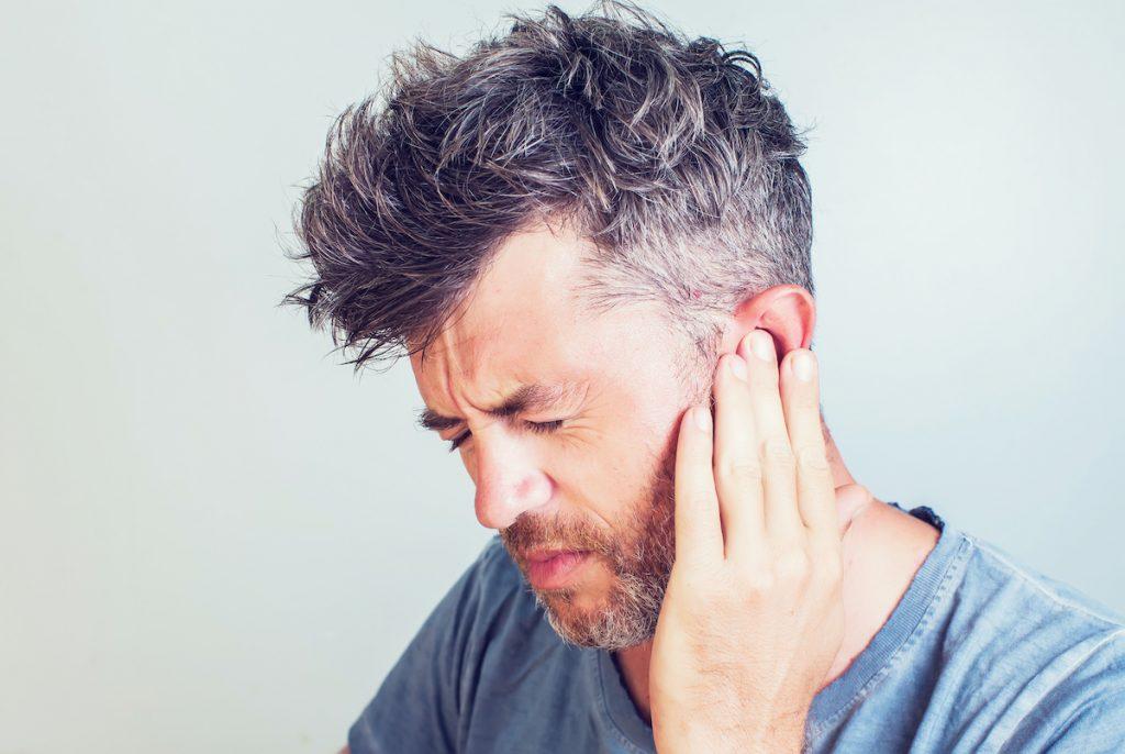 man having sore ears