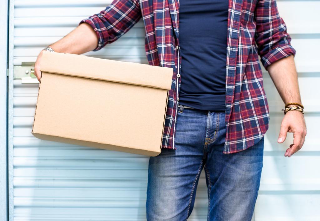man with storage box