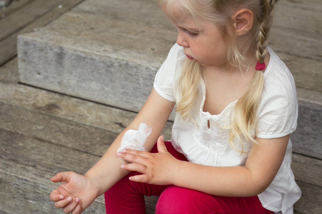 Girl applying sunscreen on skin