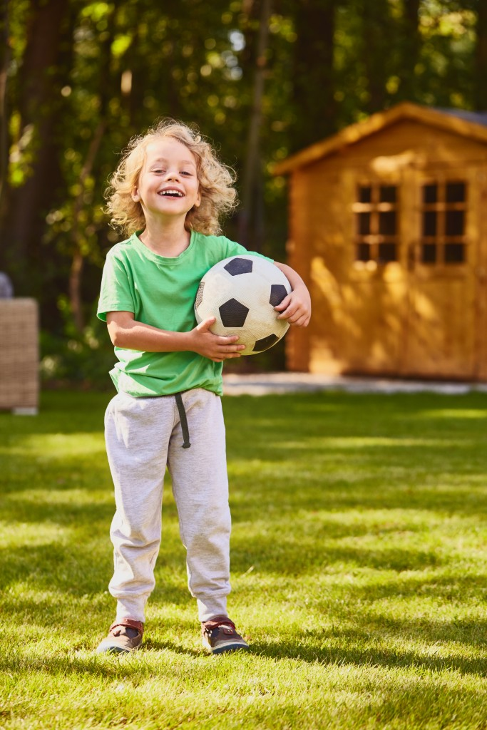 kid with soccerball