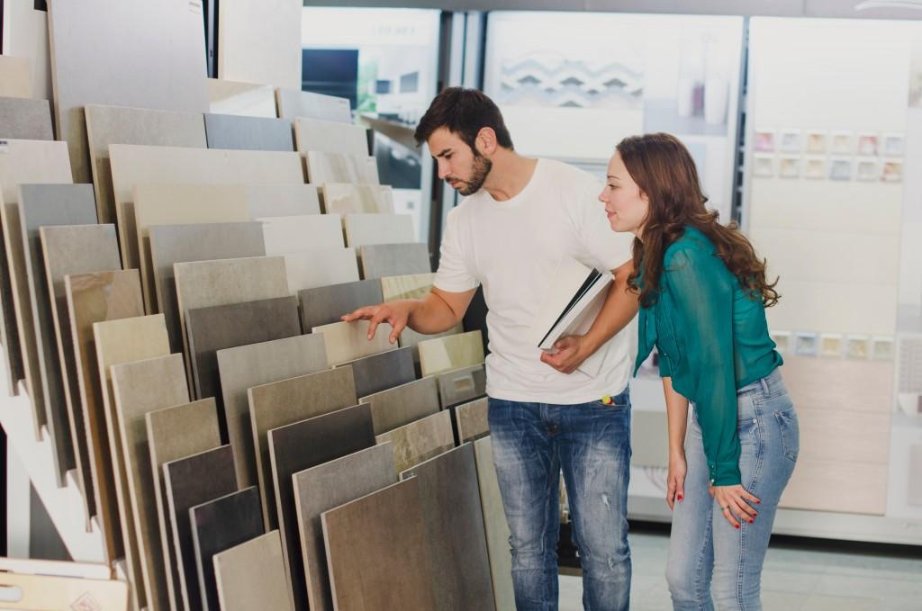 couple choosing tile