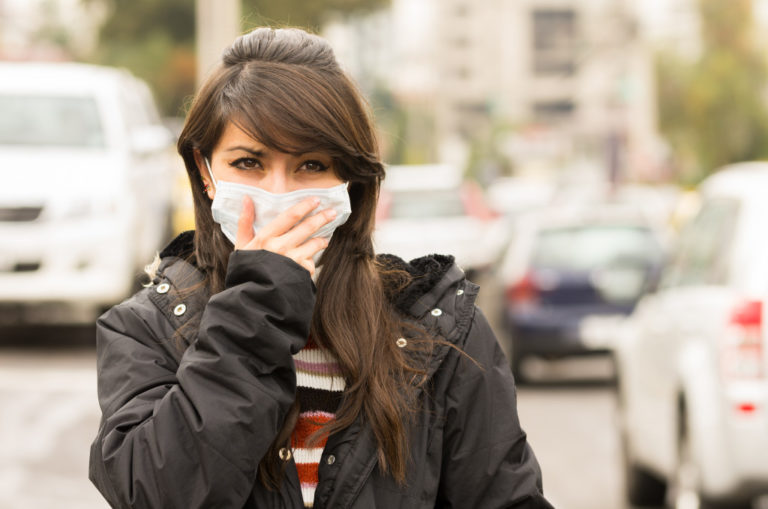 wearing a mask in a polluted area