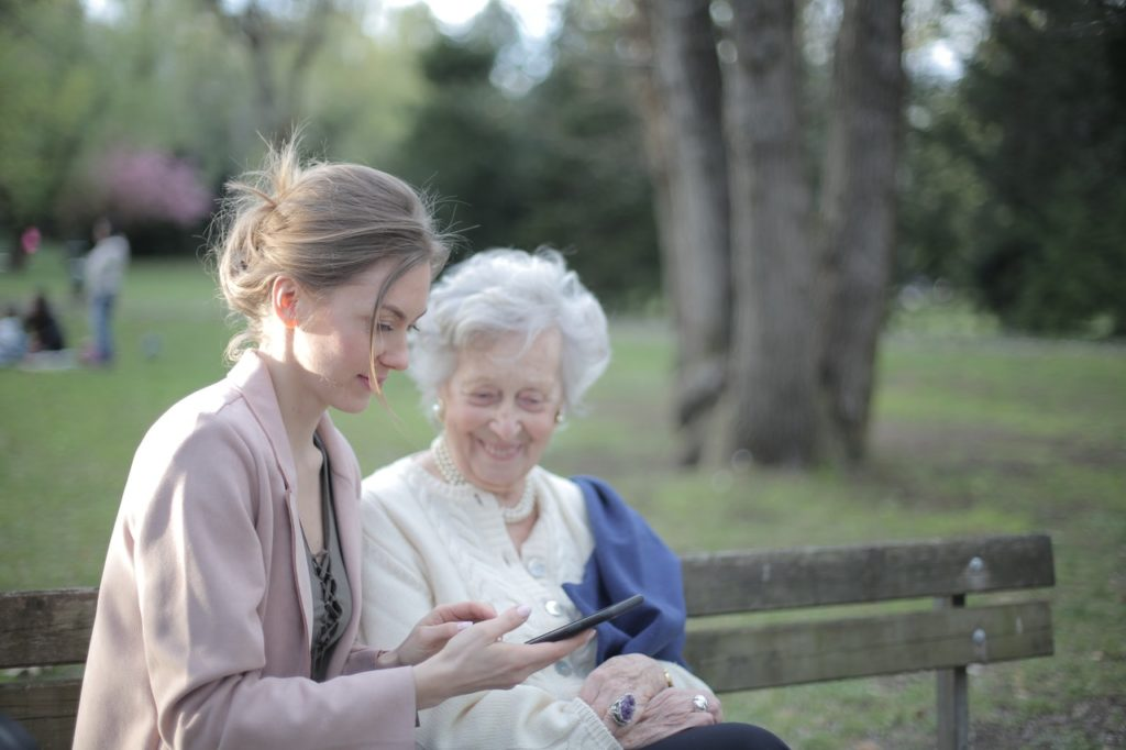 young woman talking to elder woman