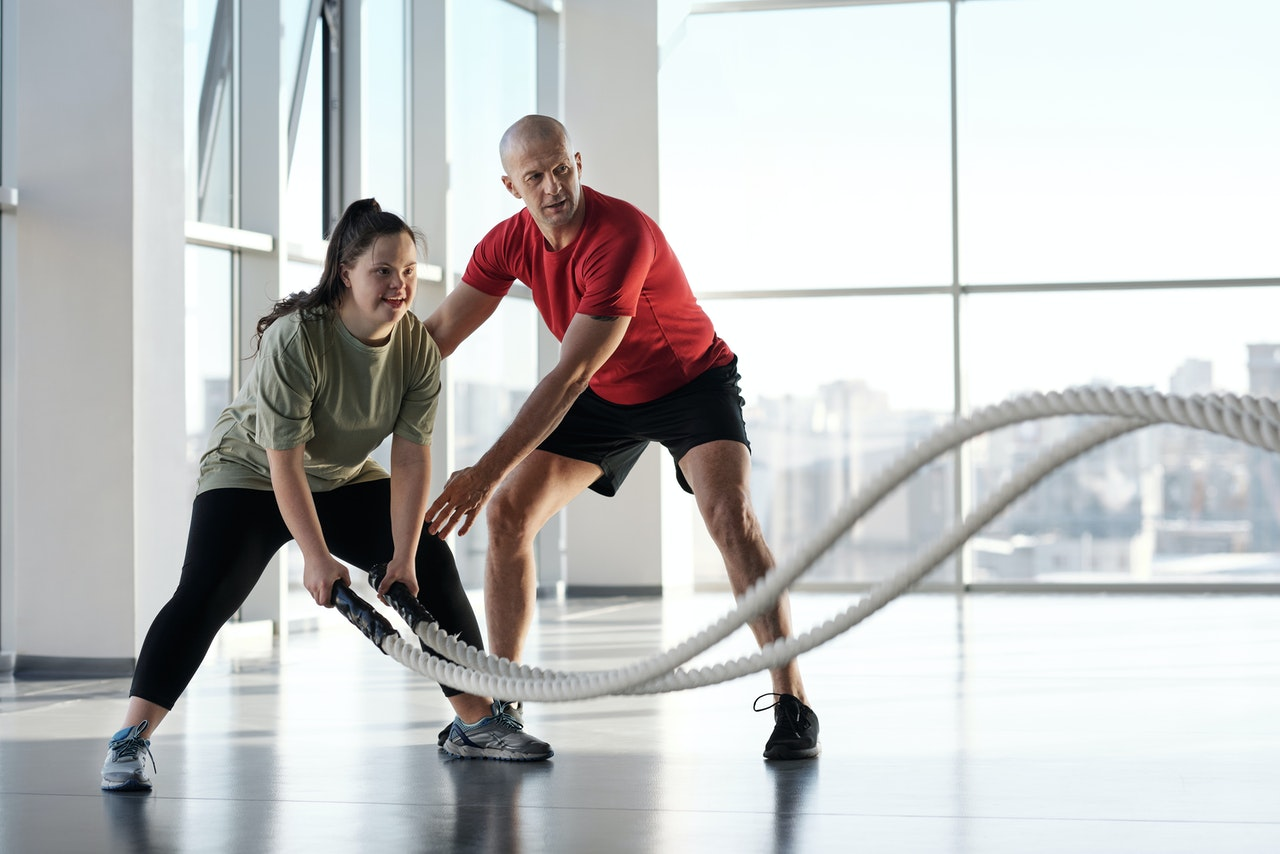 person with a coach doing a work out session
