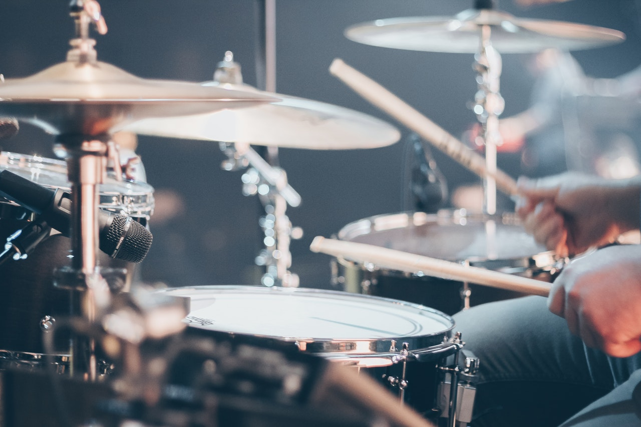 drum set being played during a live performance