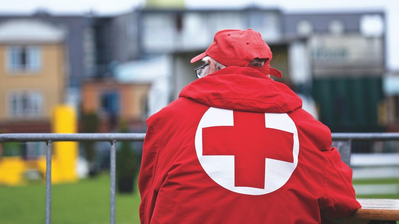 red cross logo behind jacket