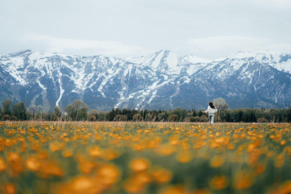 woman running through a field