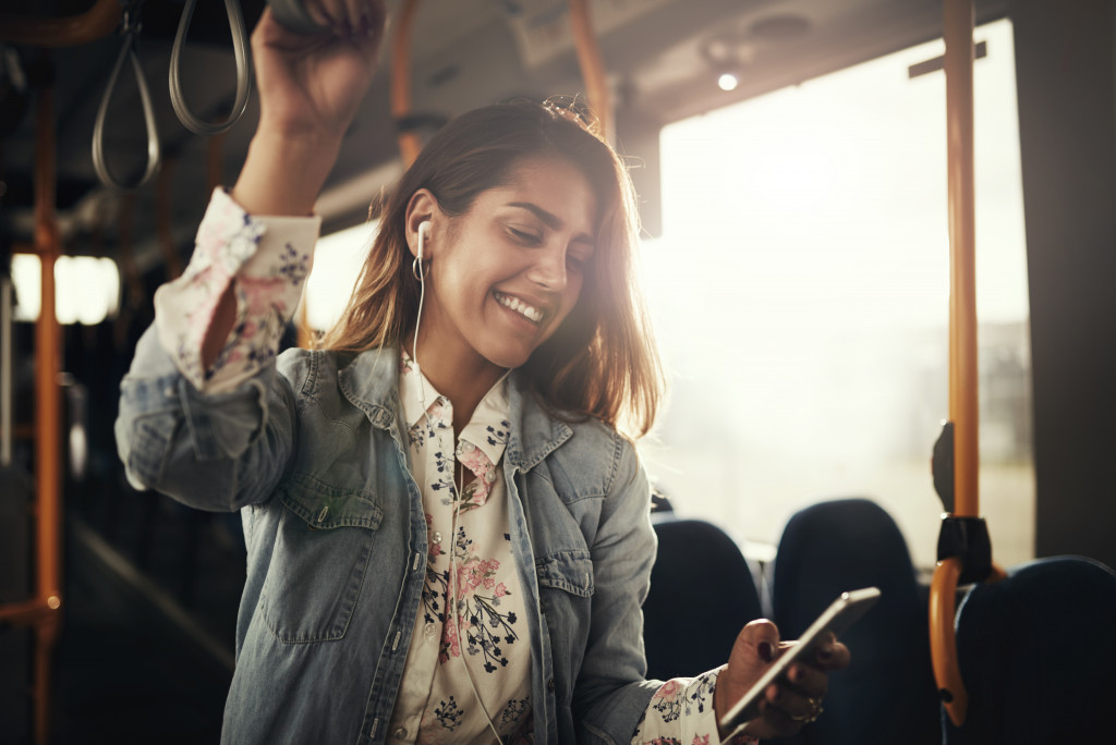 woman listening to music while in transit
