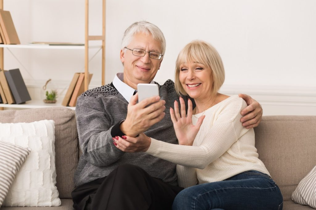 senior couple facetiming someone