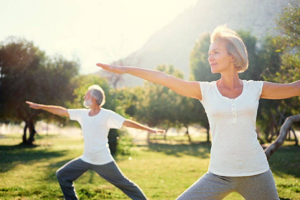 man and woman doing yoga