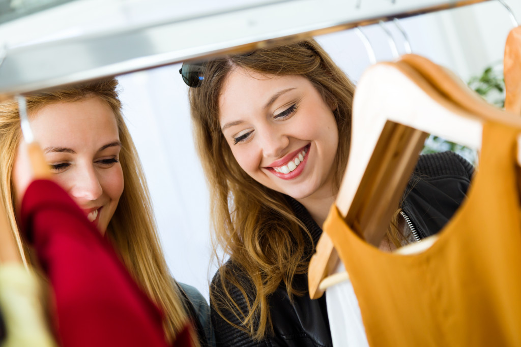 women picking clothes