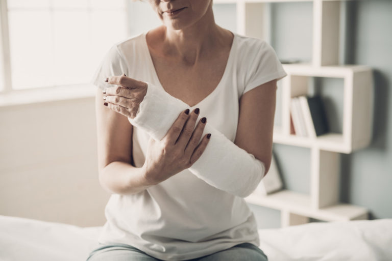 woman with injured arm