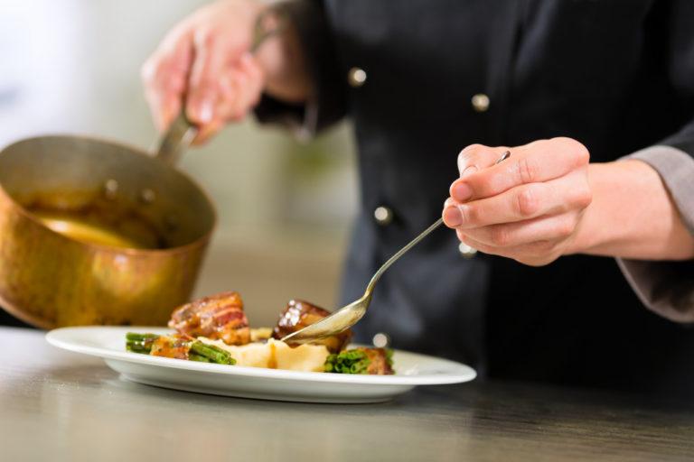 chef putting sauce