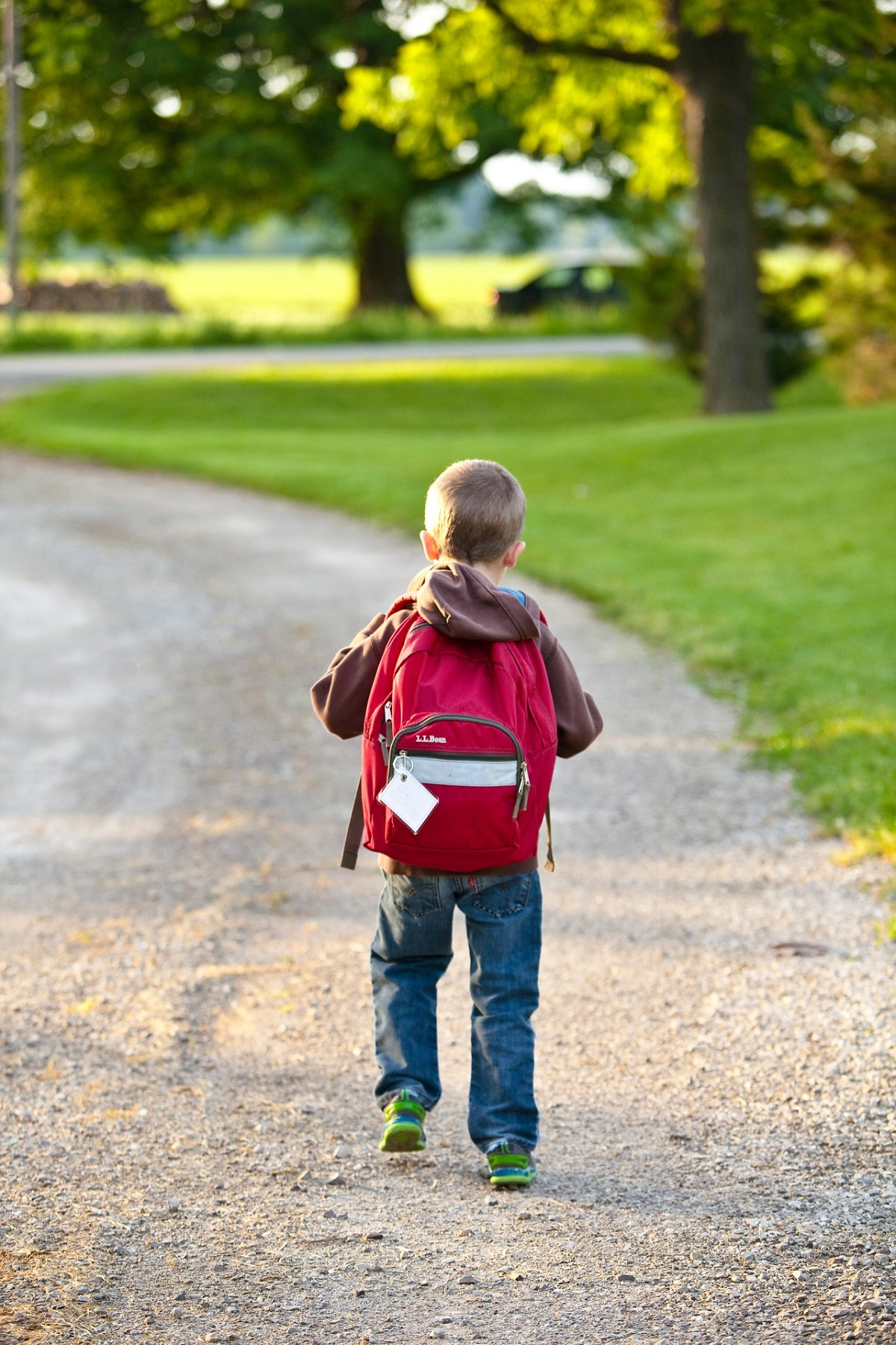 kid carrying a backpack