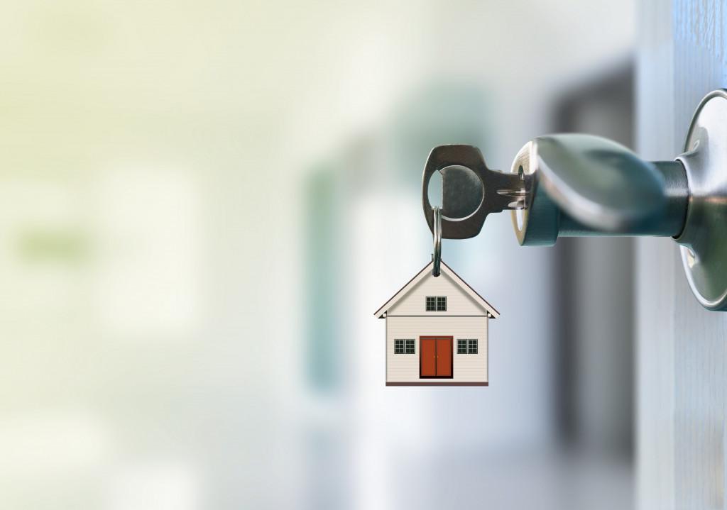 opening door with house keys