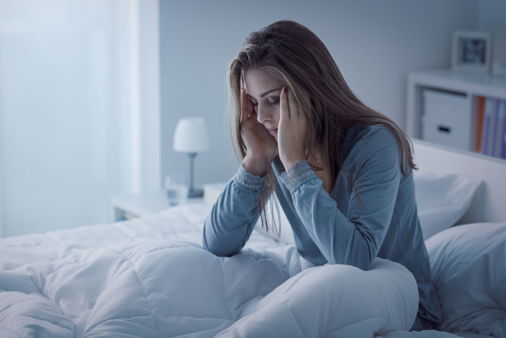 woman having headache suffering from insomnia