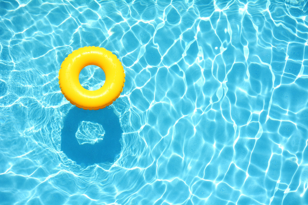 a swimming pool with a yellow floater