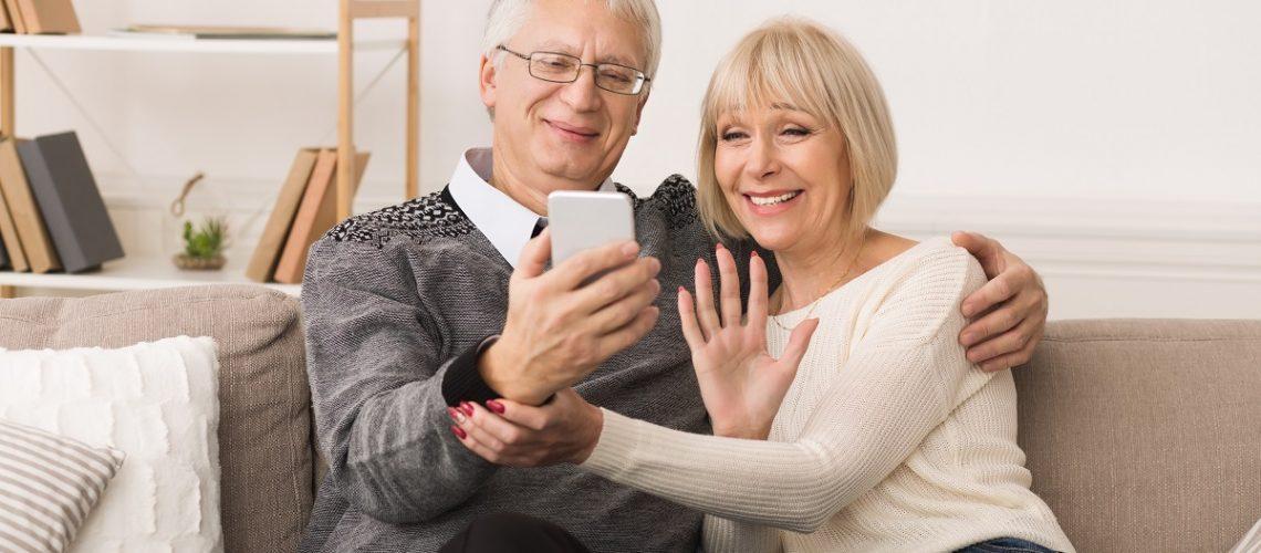 senior couple facetiming someone